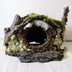 Nature Hobbit House. $95.00, via Etsy...note to self...must remember the small vine garland I have put away with Chritmas crafts...it could come in handy for the fairy doors!