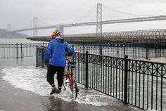 water from the bay spilling onto the sidewalk at Pier 14 along the Embarcadero during high tide in San Francisco, Calif. on Tuesday, Nov. 24, 2015. King tide conditions are causing higher than usual water levels.