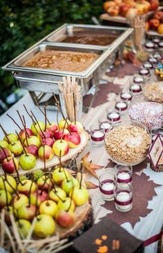 Candy apple favor station for wedding reception. See more candy apple wedding favors and party ideas at www.one-stop-party-ideas.com