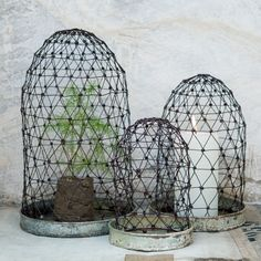 Vena Wire Display Domes    This set of three Vena wire display domes is perfect for candles or succulents in your bedroom, office or living room shelves. Handmade in India, they perfectly fit in with this season's natural living trend making them a perfect update for your home.