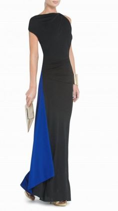 """$186.00Sophisticate draping defines this timelessly chic evening dress. Round neck. Sleeveless. Classic fit.Asymmetrical draping throughout. Slit at left side. Cowl back. Chain trim at back.Measures approximately 55"""" from shoulder to hem.Crepe: Polyester.Imported. Dry Clean"""