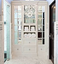 mirrored cabinets with open shelves