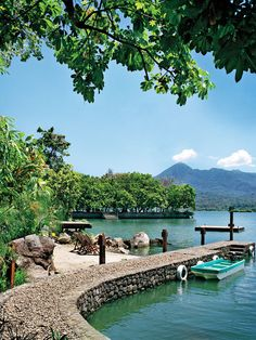 The dock of the stylish (and sustainable) Jicaro Island Ecolodge, on its own tiny island in Lake Nicaragua. In the distance is Mombacho Volcano.