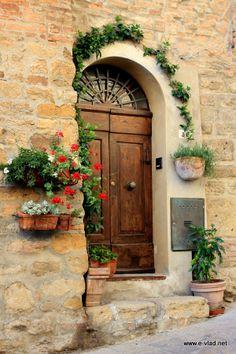 Beautiful Doors in Italy | Volterra, Italy - Flowers adn beautiful door.