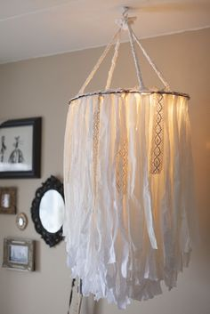 BEHOLDEN: CLOTH CHANDELIER-   I plan on getting a large hoola-hoop and a small hoola-hoop and doing this but making it into a ombre with fabric dye. Wish me luck!