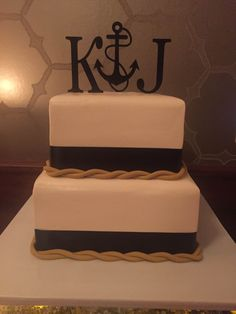 nautical theme wedding cake with gold rope and custom anchor toppers www.holiday-market.com
