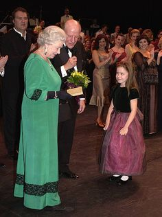 Queen Elizabeth II receives a posy as she attends a royal gala at the Wales Millennium Centre on November 28 2004 in Cardiff Wales