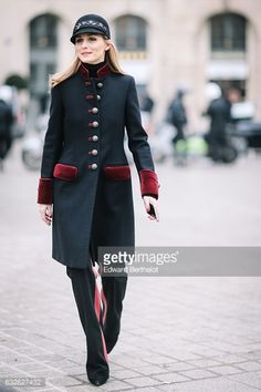 Olivia Palermo wears a cap and a military coat outside the Alexis Mabille show at Place Vendome during Paris Fashion Week Haute Couture Spring Summer...