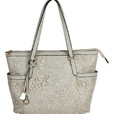 LASE  TOTE         New / Ultrafemme lace brings textural interest to this tote, while the spacious interior lends ample storage for essentials.  14.5'' W x 12.5'' H x 6.75'' D  9'' handle drop  Man-made  Lined  Zip closure  Exterior: two slip pockets  Removable logo tag  Metal feet  Imported Italy /AMORE  / AMORE  Bags Totes