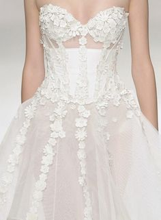 Vogue and Valium...Wow pretty details.Get that designer look by having it custom-made.Take these details & adjust to fit your style. Work with your seamstress to create that special bridal look.