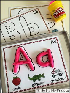"Alphabet play dough mats. Easy for beginning kindergarten because the letters on mat look like real play dough ""snakes""."