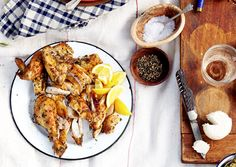 Roast Provencal Chicken :: garlic + herbes de Provence + olive oil + salt/pepper + chicken + lemon wedges | bonappetit.com