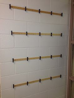 A new way to hang my students work...just some yardsticks, clothespins, gorilla…