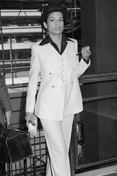 Bianca Jagger + bowler hat + white suit