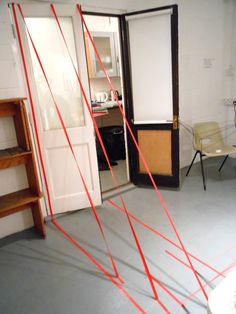 Drawing Space/Drawing in Space: Spatial drawing by Sheila using tape at a workshop facilitated by Andrea Butler for teenagers at AccessArt's Experimental Drawing Class, Cambridge