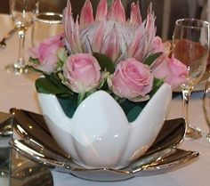 White tulip bowls with a silver base. The white tulip bowls can be used on its' own