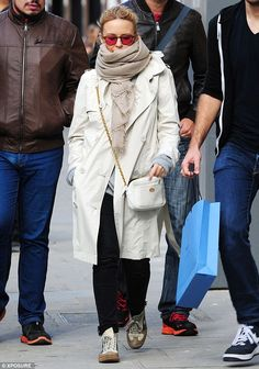 Kylie Minogue - Multi-purpose: The taupe-coloured pashmina acted as somewhat of a disguise as well as a face warmer