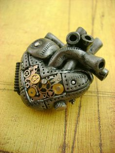 """wickedclothes:  My Heart Ticks Necklace This anatomical industrial heart is composed of several gears and watch parts. Show people how your heart ticks with this piece. Hung on an 18"""" chain with a barrel clasp. Sold on Etsy."""