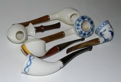 Pipes in porcelain from Royal Copenhagen, Denmark. Some of the pipes are designed by the world famous Jörn Micke.