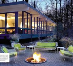 green cushions on white midcentury patio furniture (from CS Interiors, Winter 2010)