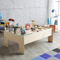 Little Colorado Handcrafted Play Table.  They make this right here in Denver.  I had one.  Still have it!
