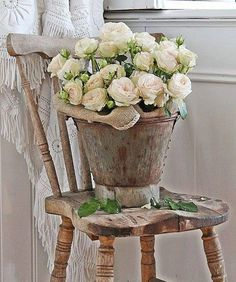 textures and tones and a bucket of roses on an antique chair VIBEKE DESIGN