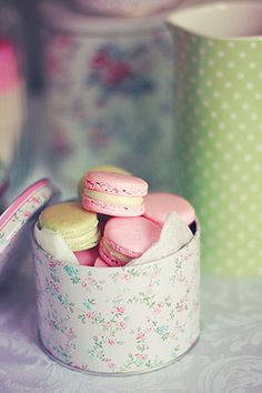 4th. I love macaroons. Plus this pic was taken soo beautifully. Am not a floral print fan, but i still like the tin in this pic.