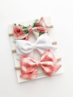 Folded Sailor Bows Headband or Clip. Choose from: Pink Floral White Swiss Dot Rose Pink Gingham Bow measures approximately 3.5 wide. Headband comes on either nude, white, or black nylon one size headband that will stretch from newborn-toddler. Can also be attached to a