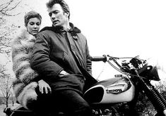 "Clint Eastwood on the set of ""Coogan's Bluff.""  Not much of a rider in his real life, Eastwood rode in several films.  In this one, he chases bad guys through Central Park on a Triumph Bonneville."