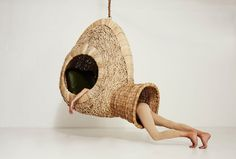 With playfulness and a pinch of humor, South African designer Porky Hefer builds hanging chairs reminiscent of natural woven nests or cocoons.