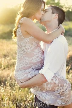 Some day when I become married and pregnant, I would love to take a picture like this with my spouse.