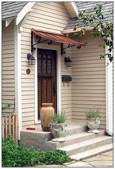 An awning or trellis over the side door would be beautiful, might need to extend over the garage door as well since they're pretty close together. Description from pinterest.com. I searched for this on bing.com/images