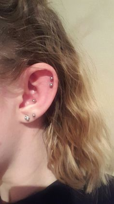 Cartlidge Peircing  Right ear: 2 x Helix, Conch and 2 x Lobe Labrets with 4mm balls Pandora studs