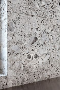 Lap(r)is integrated socket and wall cladding in Ceppo di Gre natural stone by Belgian Company Van Den Weghe
