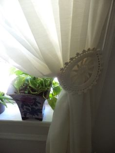 vintage doily repurposed as tie-back for sheer curtains