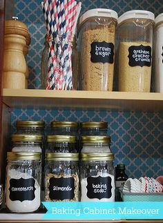 Organized baking supplies--you can see what you have using jars and a shelf riser.