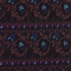 Chocolate and coffee is complemented by flecks of turquoise and navy on this midweight Italian brocade. Soft to the touch, this fabric would make an especially lovely sheath or jacket.