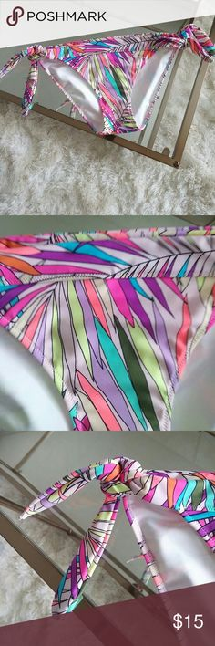 Victoria secret cute bikini bottoms side tie Very cute in very good condition. Very colourful bikiny bottoms perfect to pair with white swim top. Victoria's Secret Swim Bikinis