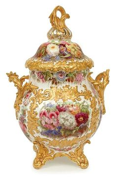 <b>A 19th century english porcelain vase and cover <br /> Possibly Coalbrookdale</b> <br /> Globular, flanked by fine acanthus handles surmounted by a campana pierced cover with conforming finial, the whole finely painted with garden flowers and raised Rococo style gilt decoration, four scroll feet, (repair to one handle), 39 cm high. <br />