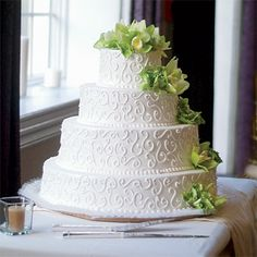 Wedding Cake with Scrolls and Orchids. A design from the invitations shows up on the cake, by Ridgefield Park, NJ%u2013based Palermo%u2019s Bakery.