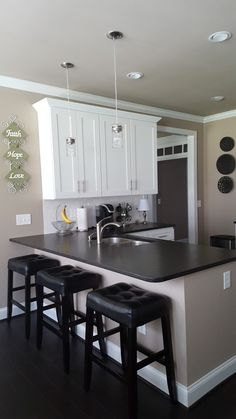 White Shaker Cabinets with Black Pearl Leathered Granite. Glossy White Subway Tile and dark hardwood floors. Kitchen Cabinet Colors, Kitchen Redo, Home Decor Kitchen, Kitchen Furniture, Home Kitchens, Kitchen Remodel, Kitchen Design, Bathroom Furniture, Furniture Projects