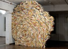 British artist Jonathan Callan creates impressive organic figures using books that are curled, wrapped, and folded together using screws.  http://nicoleklagsbrun.com/callan_home.html