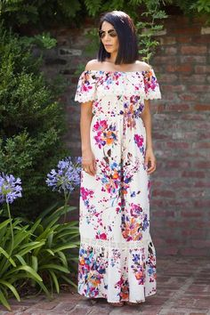 Who says mumus can't be cute? Love this pretty off the shoulder floral maxi dress for all our summer events!