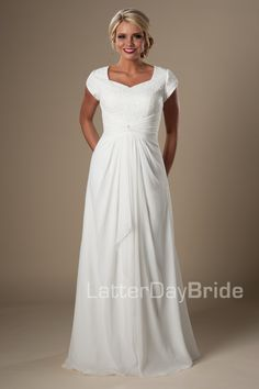 Lafayette | Modest Wedding Dress under $500 by LatterDayBride & Prom | This lovely modest bridal gown features a lace bodice with sweetheart neckline and cap petal sleeves. The gathered empire waist with center knot drapes into a flowing chiffon skirt with zipper back and court length train.    Gown available in Ivory or White    *Gown pictured in Ivory    Sleeve length or neckline can be customized.