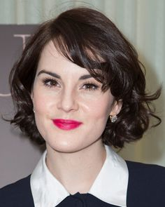 """The Downton Abbey beauty tried out a new look with supersaturated hot-pink lips and bouncy curls in her bob at the """"DuJour Magazine Celebrates Great Performances Issue"""" party."""