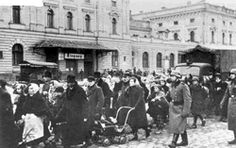 Jews deported from the Krakow ghetto, escorted by German soldiers
