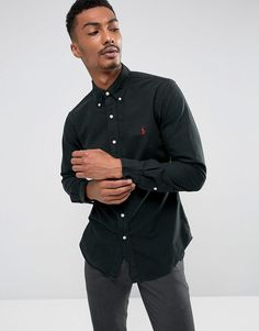Get this Polo Ralph Lauren's basic shirt now! Click for more details. Worldwide shipping. Polo Ralph Lauren Slim Fit Shirt Garment Dye Buttondown in Black - Black: Shirt by Polo Ralph Lauren, Woven fabric, Button-down collar, Button placket, Embroidered Ralph Lauren logo, Slim fit - cut close to the body, Machine wash, 100% Cotton, Our model wears a size Medium and is 187cm/6'1.5 tall. Naming his brand after a game that embodies classic style, Ralph Lauren created Polo Ralph Lauren in 1967…