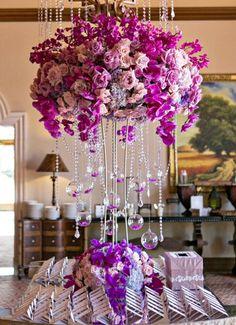 Featured Photographer: Victor Sizemore; Elegant pink flower wedding reception centerpiece