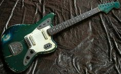 Early Fender Jaguar, looks like Lake Placid Blue with a heavily yellowed clear coat, turning it a beautiful dark green. Lake Placid Blue, Learn Guitar Chords, Fender Jaguar, Fender Electric Guitar, Rock And Roll Bands, Fender Telecaster, Guitar Picks, Cool Guitar, Bass