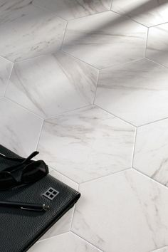 Hexagon Cararra Marble look porcelain floor tiles.   Hex tiles make great feature walls as well.  Kalafrana Ceramics Sydney Tile Showroom.: